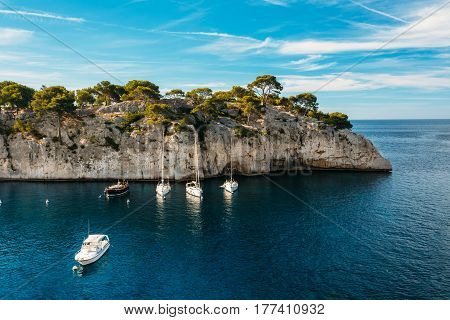 White Yachts Boats In Bay. Nature Of Calanques On The Azure Coast Of France. Calanques - A Deep Bay Surrounded By High Cliffs