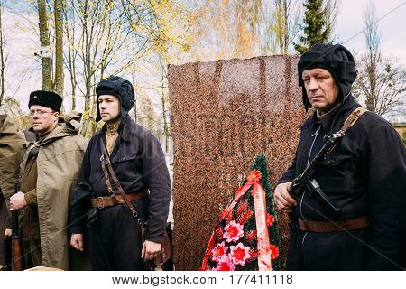 Pribor, Belarus - April 23, 2016: Re-enactors Dressed As Russian Soviet Infantry Soldiers Of World War II Standing During A Moment Of Silence At Monument In Memory Of Fallen In Great Patriotic War