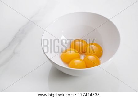 Egg yolks in bowl separated for cooking
