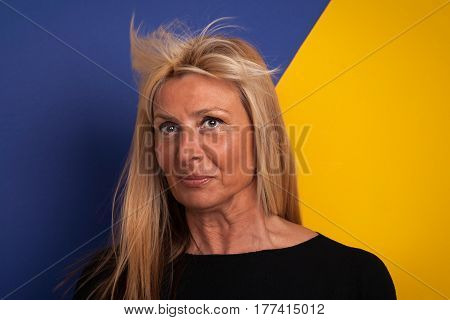Good Looking Mature Woman With a Funny Facial Expression