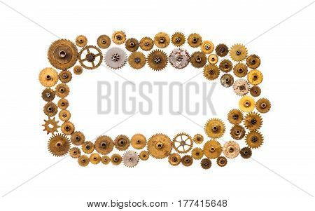 Cogs gears wheels steampunk ornament frame on white background. Vintage clockwork parts closeup. Abstract shape object with many textured aged clockwork details.
