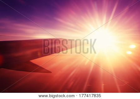 Flying Airplane Wing And Beautiful Sun Rays