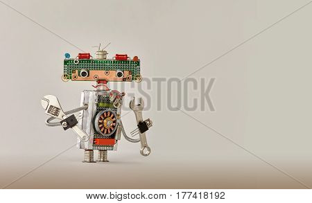 Automation robotic process concept. Hand wrench adjustable spanner handyman on beige gradient background. Friendly robot toy character made of electronic circuits, chip circuits resistors. Copy space photo poster