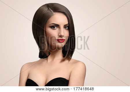 Perfect look. Fashion studio portrait of a beautiful elegant young woman with healthy shiny short hair looking to the camera copyspace beauty fashionable stylish feminine concept