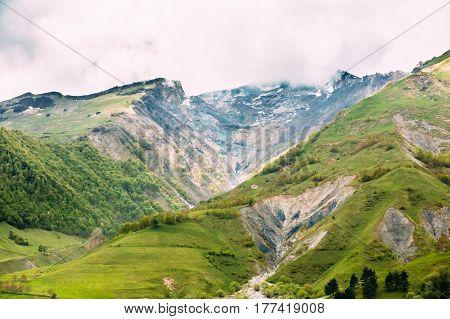 Green Spring Mountains And Rocks In Gorge Near Ganisi Village, Kazbegi District, Mtskheta-Mtianeti Region, Georgia. Spring Mountain Landscape