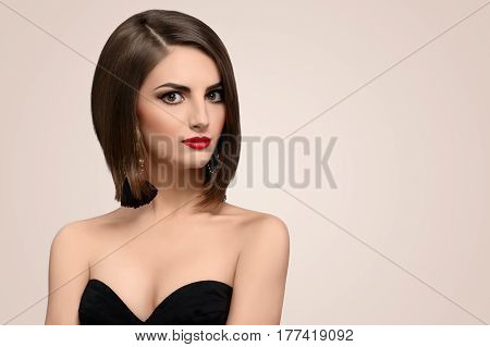 Close up studio portrait of a beautiful female fashion model wearing professional makeup with red lips looking away smiling seductively copyspace beauty skincare products fashion style hair.