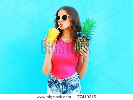 Fashion Portrait Pretty Cool Girl With Pineapple Drinking Juice From Cup Over Colorful Background