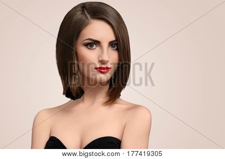 Cropped horizontal studio shot of an elegant fashionable young brunette female with red lips and smoky eyes makeup copyspace cosmetics skincare beauty luxury classy elegance concept.