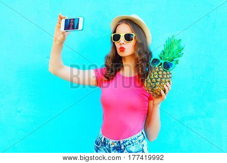 Fashion Pretty Woman Taking Picture Self Portrait On Smartphone With Pineapple Wearing Straw Hat Ove