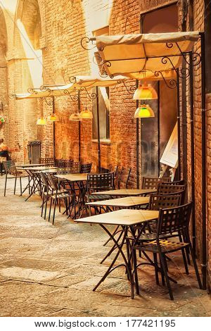 Outdoor cafe on the old street. Siena Italy.