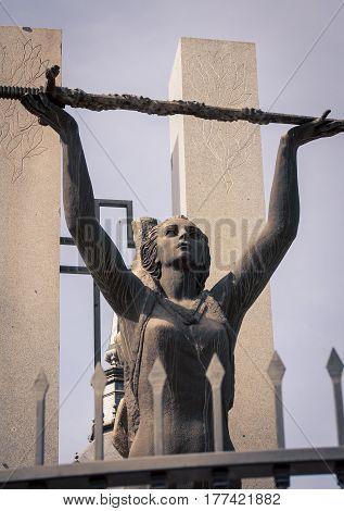 Female statue holding a sword in Toledo spain