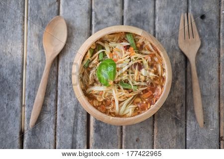 Thai papaya salad hot and spicy mixed from variety of vegetable closeup also know as Som Tam