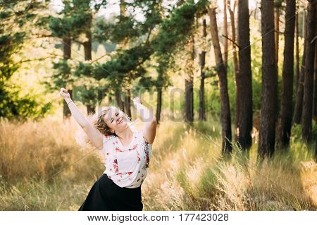Single Young Pretty Plus Size Caucasian Happy Smiling Laughing Girl Woman In White T-Shirt, Dancing In Summer Green Forest. Fun Enjoy Outdoor Summer Nature.