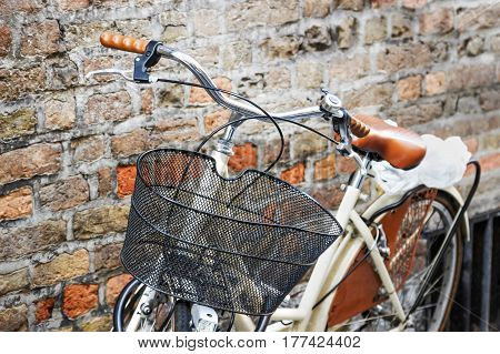 Details of white retro bicycle with basket.