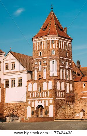 Mir, Belarus. Close Up View Of Old Towers Of Mir Castle Complex On Blue Sunny Sky Background. Architectural Ensemble Of Feudalism, Ancient Cultural Monument, UNESCO Heritage. Famous Landmark In Summer