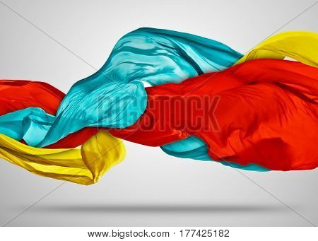 Smooth elegant colored cloth separated on grey background. Texture of flying fabric.