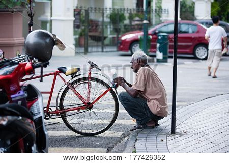 Penang, Malaysia - September 24, 2014: Vintage Trishaw stop beside road for service traveller