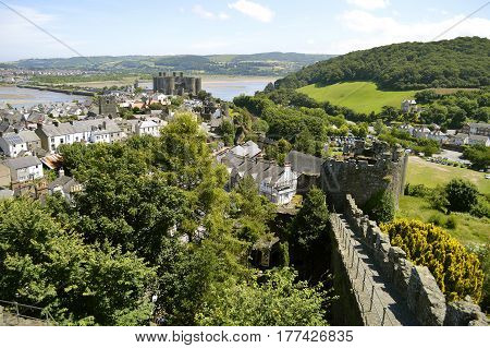 Conwy Wales United Kingdom - June 22 2014 : The historical medieval town wall surrounding Conwy town