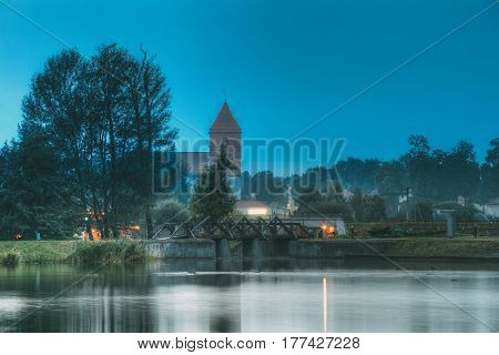 Mir, Belarus. Landscape Of Saint Nicolas Roman Catholic Church At Evening Or Night In Mir, Belarus. Famous Landmark.
