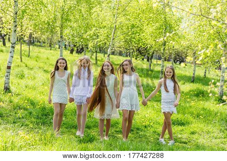 Five Beautiful Young Girls In White Dresses In Summer