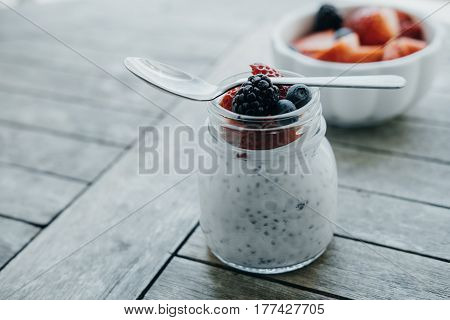 Organic Pudding With Chia Seeds And Spoon, Yogurt And Fresh Fruits: Strawberries, Blueberries And Bl