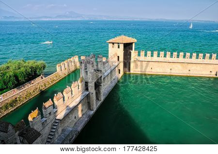 Wall of Scaliger Castle on lake Garda Sirmione Italy