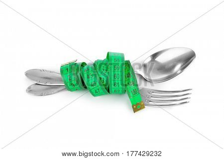 Fork spoon and measuring tape isolated on white background