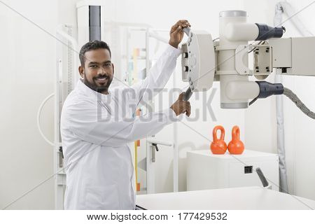 Male Radiologist Operating X-ray Machine In Hospital