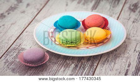 Macaroons Cookies On Blue Plate