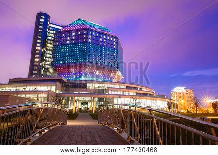 Minsk, Belarus - April 6, 2016: National Library Building In Evening LED Illumination On Blue Sky Background. Famous Hi-Tech Modern Landmark, Cultural Informational Science Center. Night Panorama
