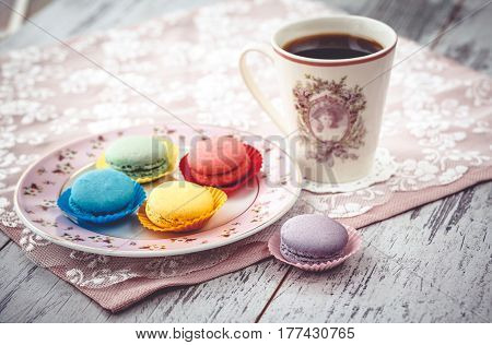 Macaroon And Coffe On Table With Napkin