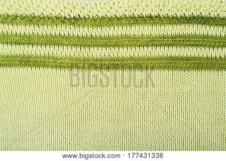 Sweater or scarf fabric texture large knitting. Knitted jersey background with a relief pattern. Wool hand- machine handmade