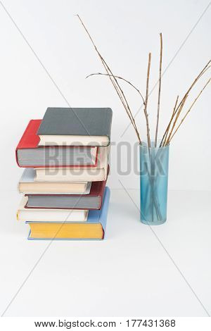 Book stacking. Open book hardback books on wooden table and white background. Back to school. Copy space for text.