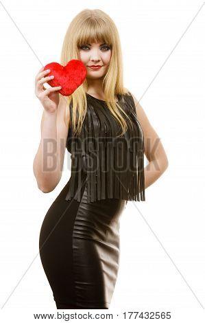 Woman elegant blonde long hair girl dark makeup red lipstick black evening dress holding red heart love symbol flirting on white. Valentines day happiness concept