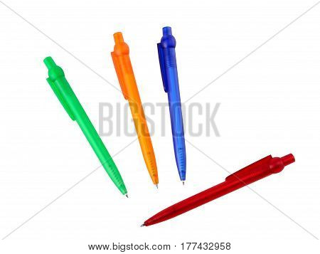 Four multicoloured ball point pens isolated on white