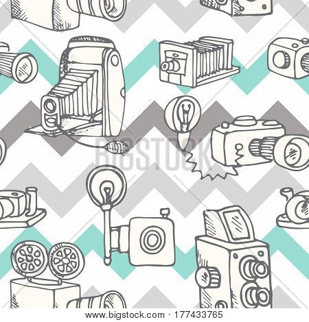 Sketchy vector hand drawn doodle cartoon set of retro photo cameras in black outline, against abstract stripped geometric background, vector illustration