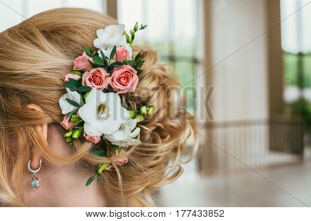Pretty and tenderless young bride with flower decoration in her hair