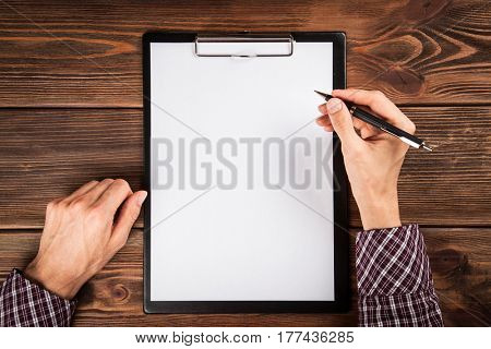 Clipboard on a wooden table