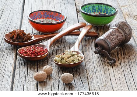 Nutmeg on a rustic table with other spices