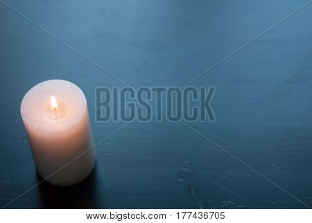 White Candle On A Black Background,