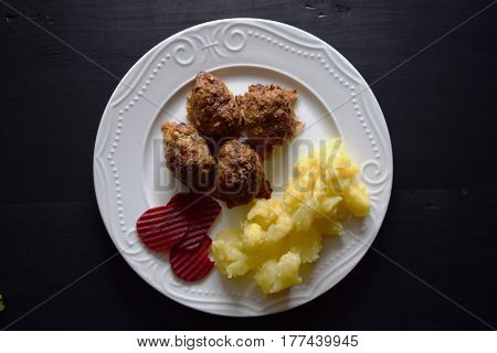 Fried minced meat with  potatoes on white  plate, vegetables . Delicious meal of minced meat