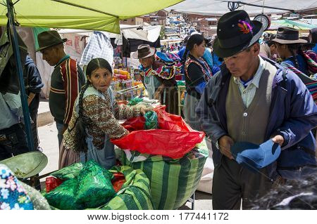 Betanzos Bolivia - December 1 2013: Woman selling coca leaves in a street market in the small town of Betanzos in Bolivia.