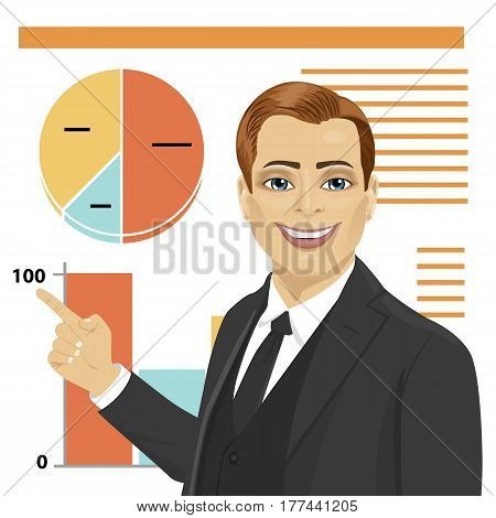 Confident young businessman standing next to flip chart and pointing graph with graph and diagram. Creative business concept.
