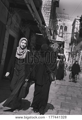 JERUSALEM, ISRAEL - MARCH 06, 2017: Arab quarter of the old city. Women in burqa