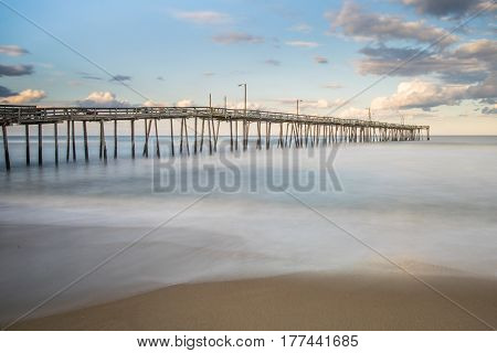 Long exposure of fishing pier along the beach of the Outer Banks of North Carolina