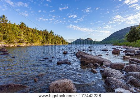Morning along the rocky shoreline of Jordan Pond in Acadia National Park Mount Desert Island Maine