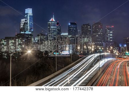 Philadelphia night skyline at rush hour along the Schuylkill Expressway