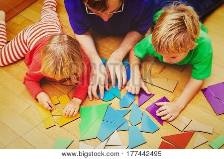 teacher and kids playing with geometric shapes, learning concept