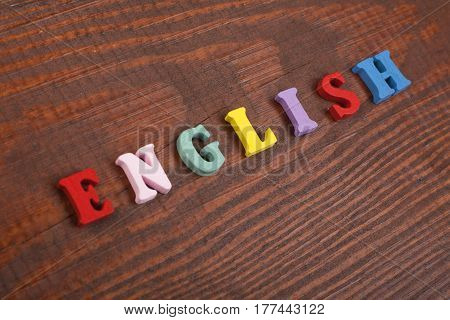 English word on wooden background composed from colorful abc alphabet block wooden letters copy space for ad text. Learning english concept