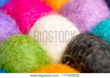 color wool background - balls of synthetic wool yarn - geometric rainbow pattern